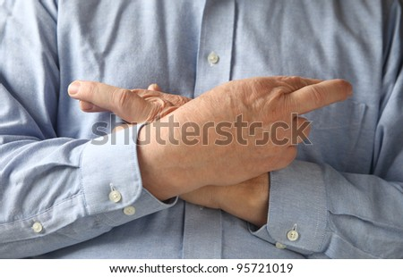 superstitious man hopes for luck - stock photo