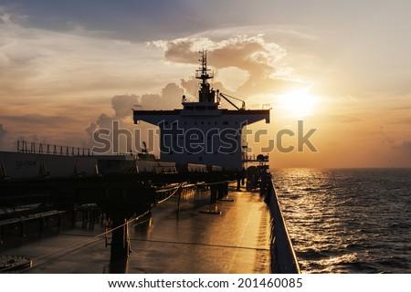 Superstructure of the cargo ship at sunset - stock photo