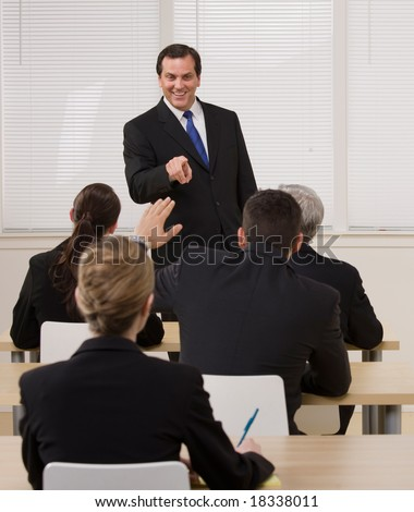 Supervisor answering questions from co-worker in presentation - stock photo