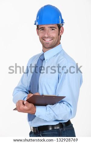 Supervisor holding clipboard - stock photo