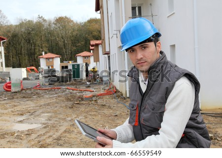 Supervisor on construction site - stock photo