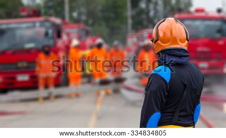 Supervisors were turned back turned firefighter standing with the fire department, which prepared. - stock photo