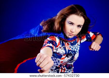 Superwoman. On blue background. Portrait. - stock photo