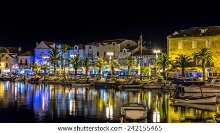SUPETAR, CROATIA - July 23, 2014: Panorama of the city port with moored boats in the summer night on island Brac.