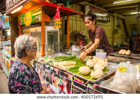 Suphan Buri, Thailand - Apr 3, 2016 -A woman sell giant meatballs at Samchuk market
