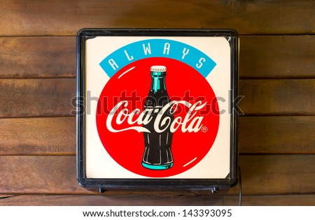 SUPHANBURI, THAILAND-JUNE 16: Light box coca-cola at old shop, Classic light box advertising Coca-cola brand in stores an old market town on June 16, 2013 in Suphanburi, Thailand - stock photo