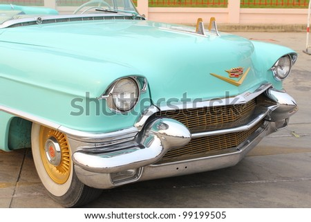 """SUPHANBURI, THAILAND - MARCH 31: American muscle old car Cadillac exhibited at the annual motor show """"American Car Carnival"""" on March 31, 2012 in Suphanburi, Thailand. - stock photo"""