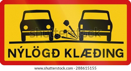 Supplementary road sign with the words in Icelandic: Newly-laid road surface - stock photo
