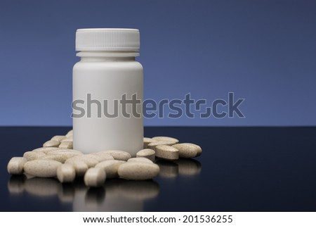 Supplements, medications or vitamin bottle - stock photo