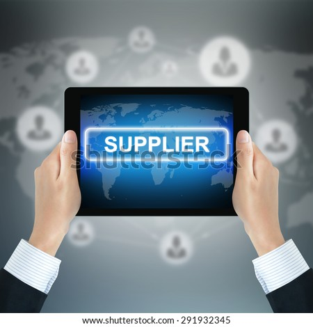 SUPPLIER text on tablet pc screen held by businessman hands