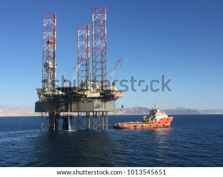 Supply boat and Jackup Rig in the Gulf of Suez