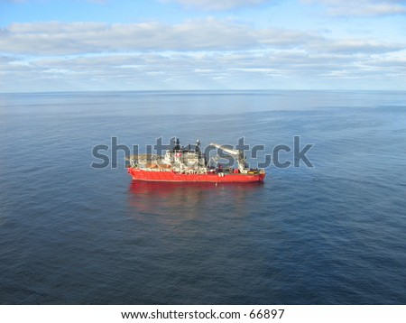 Supply boat on oil field. - stock photo