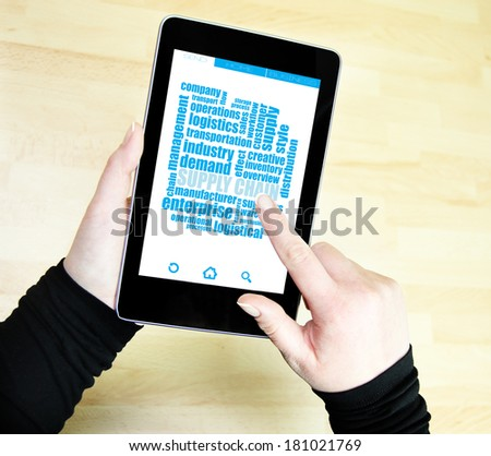 supply chain wordcloud on tablet - stock photo