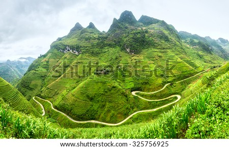 Supply lines of Ma Pi Leng Pass rugged northwest Vietnam's most beautiful with winding road full of clouds mountainside. We come to love the country of Vietnam more - stock photo