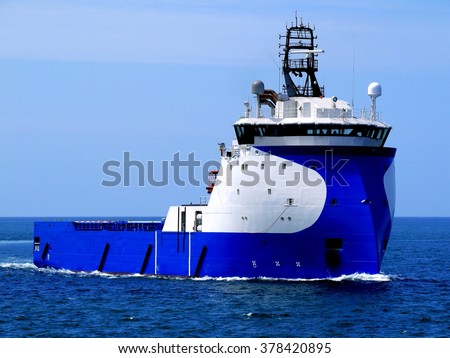 Supply Ship D, Offshore Supply Vessel underway at sea to offshore installation. - stock photo