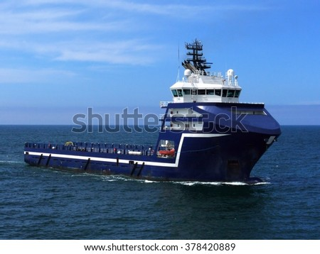 Supply Ship M, Offshore Supply Vessel underway at sea to offshore platform. - stock photo