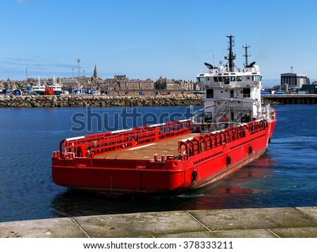 Supply Ship, Offshore Supply Vessel in port maneuvers to load supplies for offshore installation. - stock photo