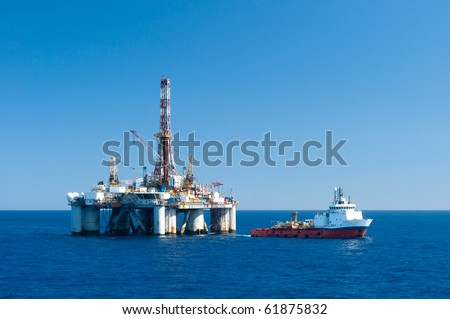 Supply vessel during operation along side with a drilling rig.  Coast of Brazil