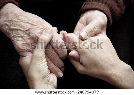 Support and help the elderly - stock photo