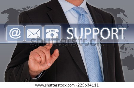Support - Businessman with contact options on touchscreen - stock photo
