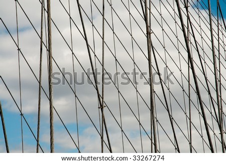 support cables of the Brooklyn Bridge and blue sky with clouds