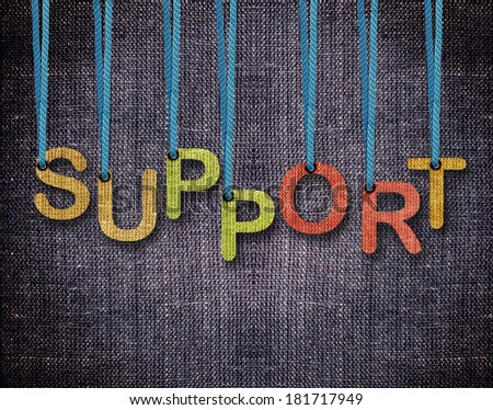 Support Letters hanging strings with blue sackcloth background. - stock photo