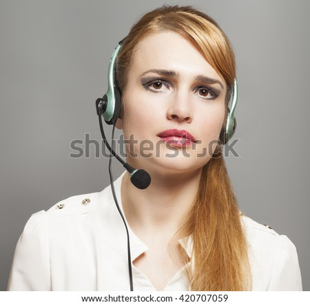 Support phone operator in headset  on gray background - stock photo