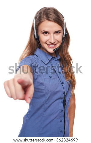 Support phone operator in headset smiling looking at camera and pointing at you, isolated on white - stock photo