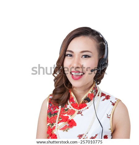 Support phone operator in headset. Smiling mixed chinese asian / caucasian woman. Isolated on white background.