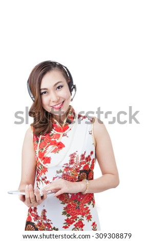 Support phone operator in headset. using digital tablet computer PC happy isolated on white background. Beautiful mixed race Asian with finger on touch screen display. Isolated on white background. - stock photo
