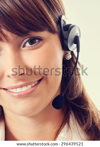 Support phone operator in white business style clothing in headset - stock photo