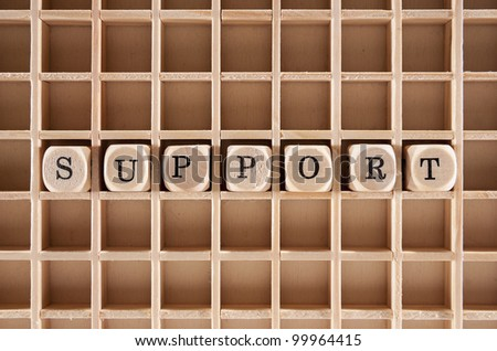 Support word construction with letter blocks / cubes and a shallow depth of field - stock photo