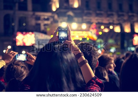 Supporters recording at concert - Candid image of crowd at rock concert - stock photo