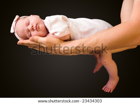 Supporting Hands. Father holding his 14 days old baby girl on his arms - stock photo