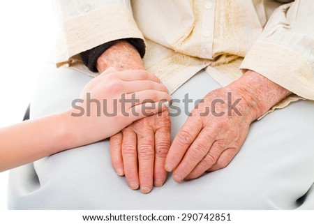 Supporting hands for senior woman. - stock photo