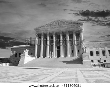 Supreme court building exterior with sunset sky in black and white. - stock photo