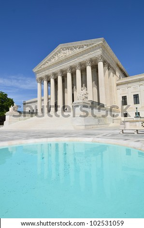 Supreme Court Building with mirror reflection on the pool - stock photo