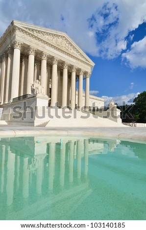Supreme Court Building with mirror reflection on the pool in a partly cloudy day