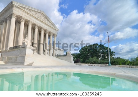 Supreme Court Building with mirror reflection on the pool in a partly cloudy day - Washington DC - stock photo