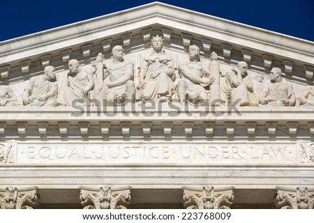 Supreme Court of the United States in Washington D,C. Blue sky behind. Ornate frieze on top of courtroom. - stock photo