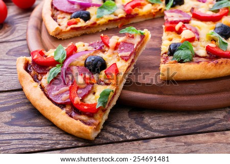 Supreme Pizza lifted slice 1 - stock photo