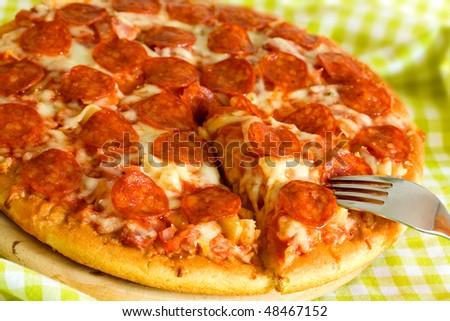 Supreme Pizza with Salami,Cheese,Pineapple - stock photo