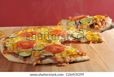 Supreme vegetarian Pizza Slice lift - stock photo