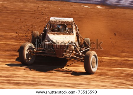 SUPRISE, AZ - APR 16: Justin Smith (19) at speed in Pro Buggy Unlimited Lucas Oil Off Road Series racing on April 16, 2011 at Speedworld Off Road Park in Avondale, AZ. - stock photo
