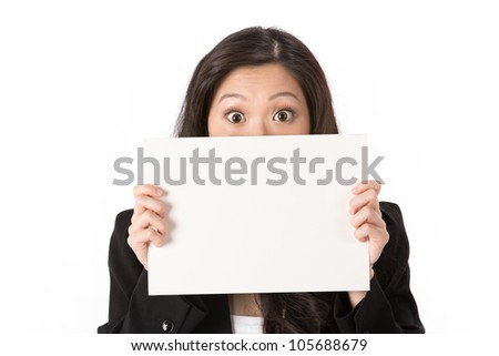 Suprised Asian Business woman holding an empty white sign. - stock photo