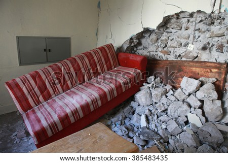 SUR, DIYARBAKIR - FEBRUARY 10: A house is seen just after it was hit by a mortar during clashes between Kurdish protesters and Turkish police. The Photo Taken February 10, 2016. - stock photo
