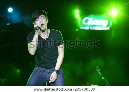 SURAT THANI, THAILAND - FEBRUARY 21 : Rooftop Band performs at Chang Music Connection Concert on February 21, 2015 in Surat Thani, Thailand. Rooftop is a Thai rock band, formed in 2012. - stock photo