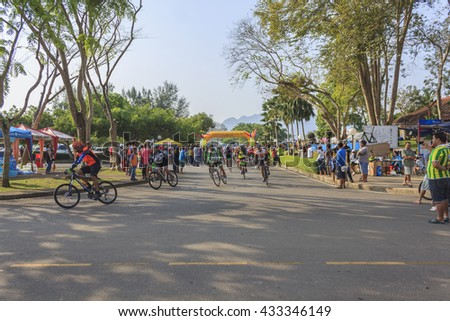 SURAT THANI, THAILAND - FEBRUARY 1: The race athletes at the start of a cycling race of The Khao Sok marathon on February 1, 2015 in Surat Thani, Thailand.