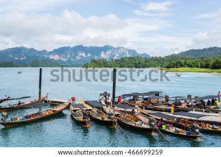 Surat Thani, Thailand - JULY 18, 2016: Long tailed boats are waiting for tourists who want to travel around Ratchaprapa or Chiew Lan dam Khao Sok