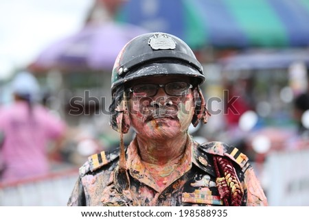 SURATTHANI, THAILAND- APRIL 13: Unidentified Thai police with painted face for celebrate Songkran Festival on April 13, 2014 in Suratthani, Thailand. Songkran is the most famous festival in Thailand.